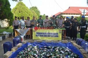 Ratusan Botol Miras Hasil Razia Polres Tulangbawang Dimusnahkan