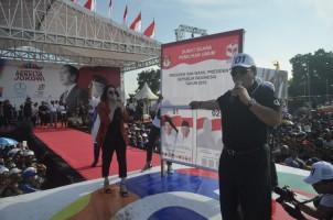 Kampanyekan Jokowi, Arinal Akan Bangun Pabrik Pengolah Karet