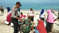 Peringati HPSN, Tim Gabungan Bersih-bersih Pantai Labuhan Jukung