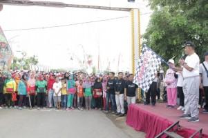 Ribuan Warga Ikuti Jalan Sehat dan Fun Bike Peringati Satu Dasawarsa Pringsewu
