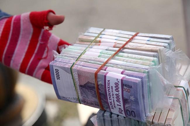 Rupiah Melemah Tipis ke Posisi Rp13.584/USD