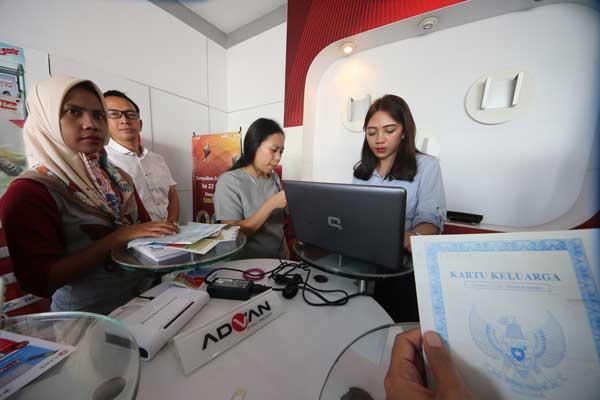 LAMPUNG POST | Sengkarut Registrasi SIM Card