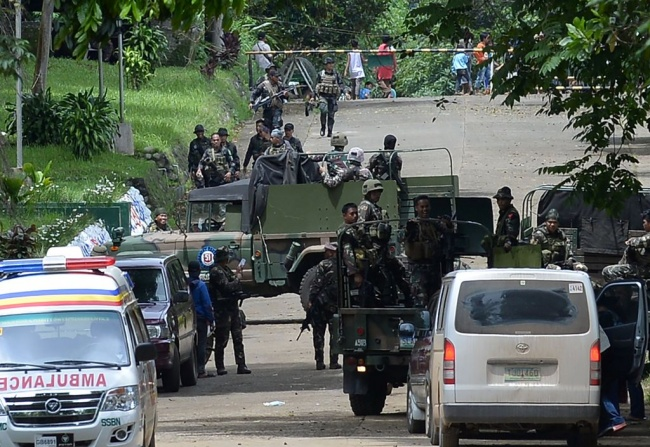 LAMPUNG POST | Tentara Filipina Rebut Kembali 90 Persen Kota Marawi dari Kelompok Maute