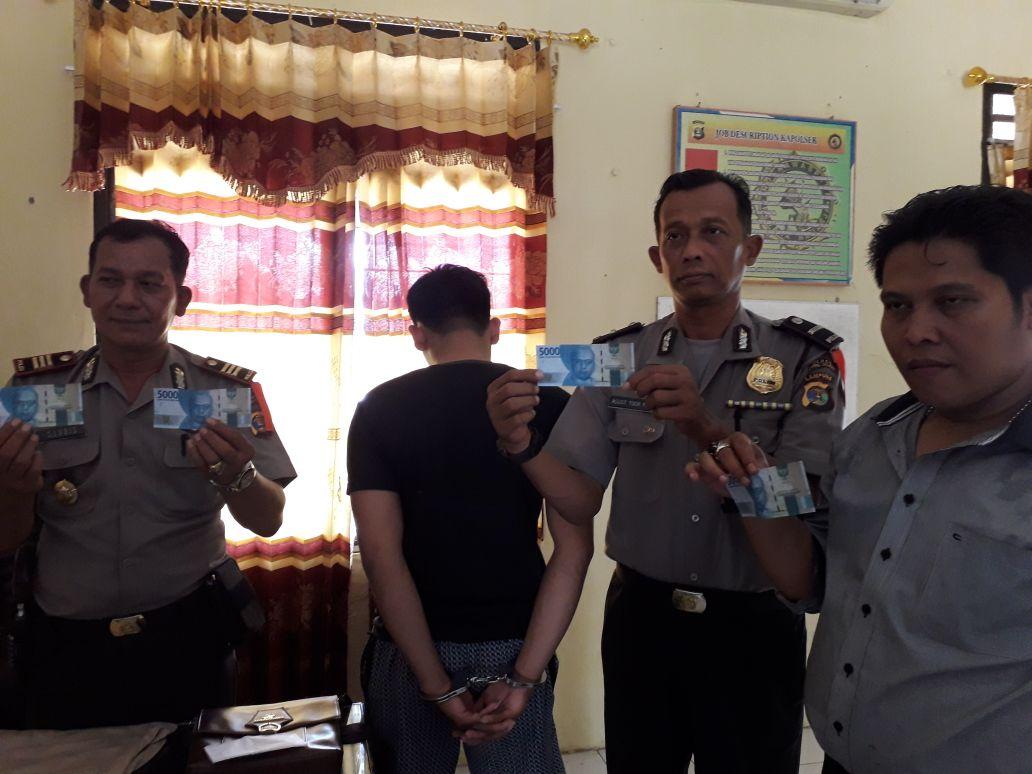 Polisi Bekuk Pengedar Uang Palsu di Kotaagung