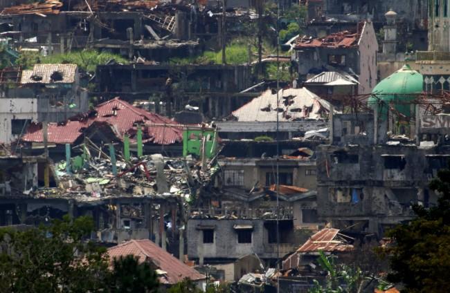 LAMPUNG POST | 8 Warga Asing Ikut Berperang Bersama Kelompok Militan di Marawi