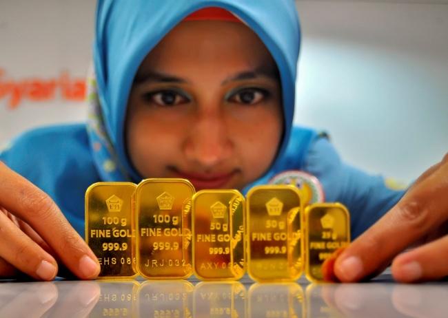 LAMPUNG POST | Akhir Pekan, Harga Emas Nangkring di Rp604.000/Gram