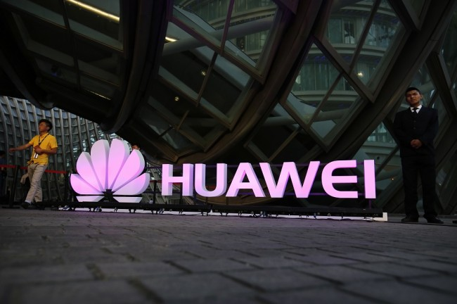 Eksekutif Huawei Ditangkap atas Tuduhan Terima Suap
