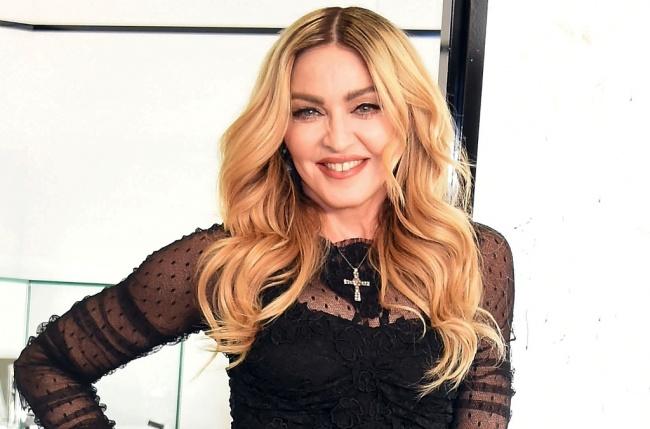 LAMPUNG POST | Madonna Beberkan Perjuangannya Mengadopsi Mercy