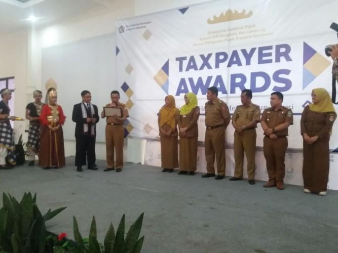 Lampura Raih Gelar Juara Umum Taxpayer Awards